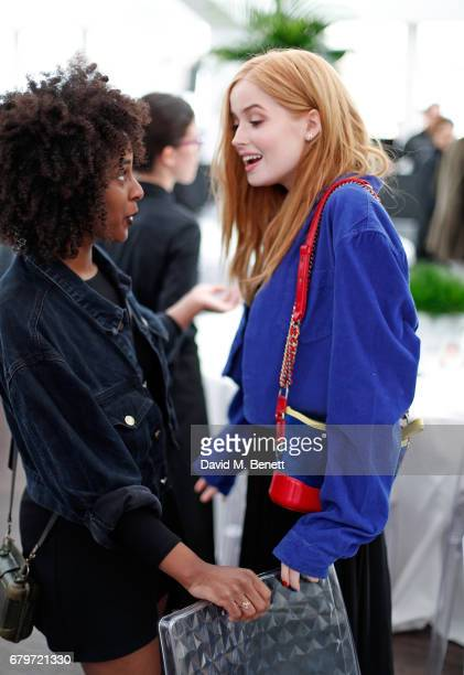 Guest and Ellie Bamber attend the Audi Polo Challenge at Coworth Park on May 6 2017 in Ascot United Kingdom