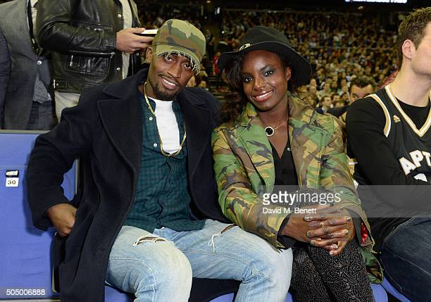 A guest and Eni Aluko attend Orlando Magic vs Toronto Raptors NBA Global Game at The O2 Arena on January 14 2016 in London England