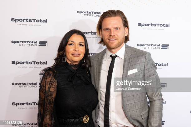 Guest and Eugen Polanski attend the SportsTotal Christmas Party and foundation gala at Flora Koeln on December 01, 2019 in Cologne, Germany.