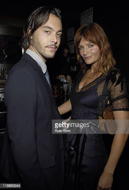 Guest and Helena Christensen during Olympus Fashion Week Spring 2007 Marchesa After Party at Double Seven in New York City New York United States