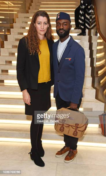 Guest and Inua Ellams attend the re-opening of the Royal Opera House on September 20, 2018 in London, England.