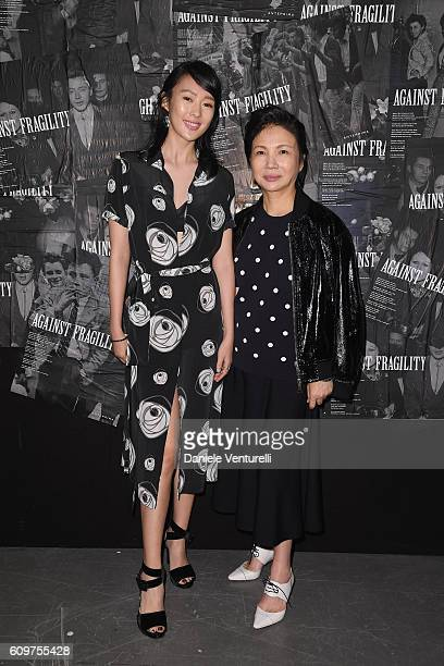Guest and Izumi Ogino attends the Anteprima show during Milan Fashion Week Spring/Summer 2017 on September 22 2016 in Milan Italy