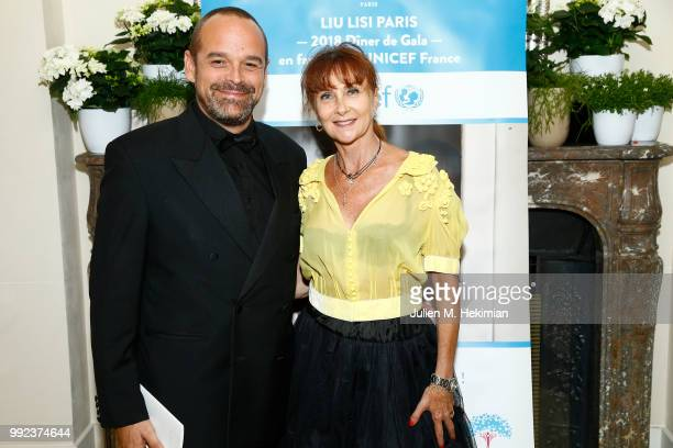 A guest and Judith Girard attend the Liu Lisi Charity Gala Dinner with Unicef at Hotel Plaza Athenee on July 5 2018 in Paris France
