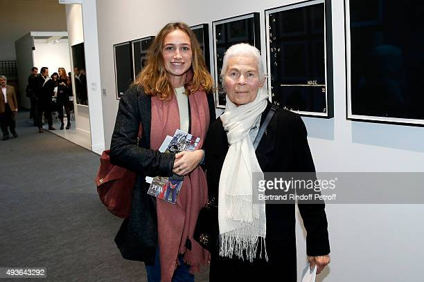 Guest and Miss Jacques ChabanDelmas attend the 'FIAC 2015 International Contemporary Art Fair' at Le Grand Palais on October 21 2015 in Paris France