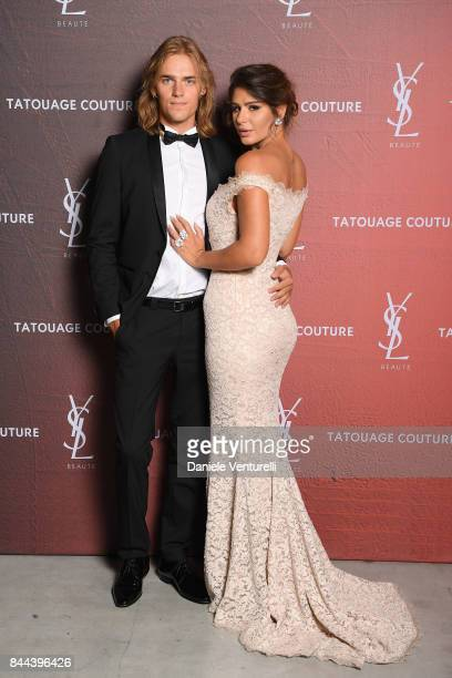 Guest and Nima Benati attend the YSL Beauty Club Party during the 74th Venice Film Festival at Arsenale on September 8 2017 in Venice Italy