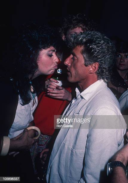 guest and Roger Daltrey of The Who during Amadeus Premiere September 12 1984 at Lowe's Tower East Theater in New York New York United States