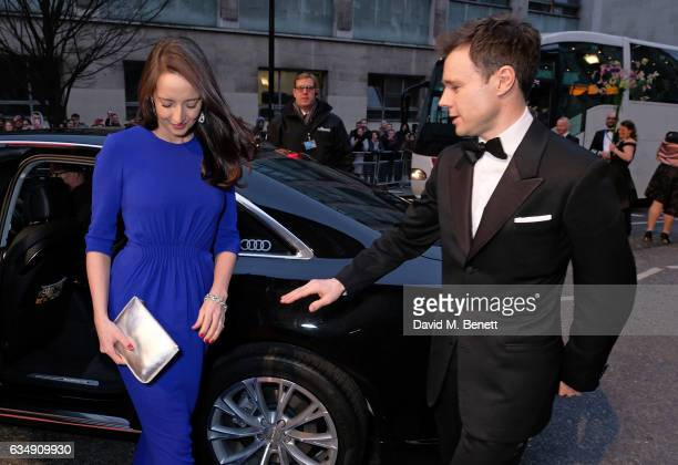 Guest and Rupert Evans arrive in an Audi at the EE BAFTA Film Awards at the at Royal Albert Hall on February 12 2017 in London England