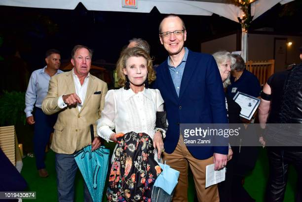 Guest and Scott Howe attend the Animal Rescue Fund Of The Hamptons Bow Wow Meow Ball at ARF Adoption Center on August 18 2018 in Wainscott New York