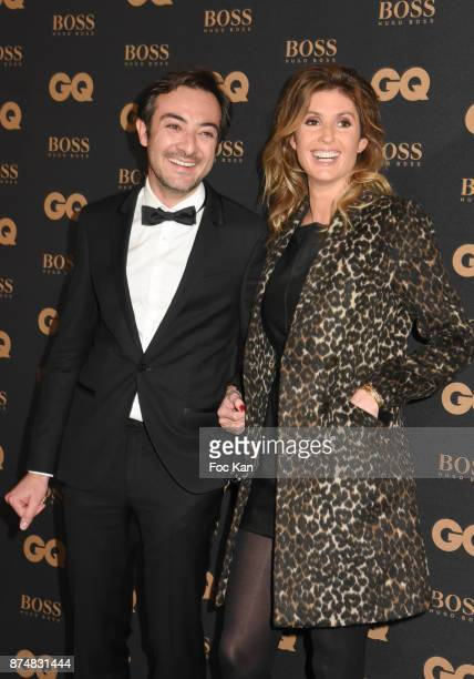 A guest and TV presenter Caroline Ithurbide attend the Les GQ Men Of The Year Awards 2017 Photocall at Trianon on November 15 2017 in Paris France