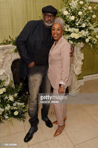 Guest and Yvonne Thompson attends the British Vogue and Tiffany Co Fashion and Film Party at Annabel's on February 2 2020 in London England