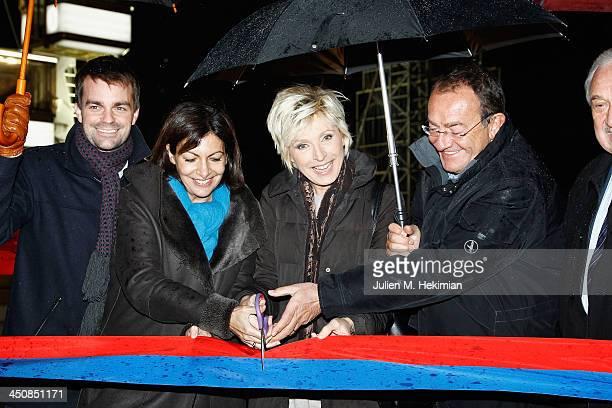 Guest Anne Hidalgo Evelyne Dheliat and Jean Pierre Pernaut launch the Paris Christmas illuminations at the ChampsÉlysées on November 20 2013 in Paris...