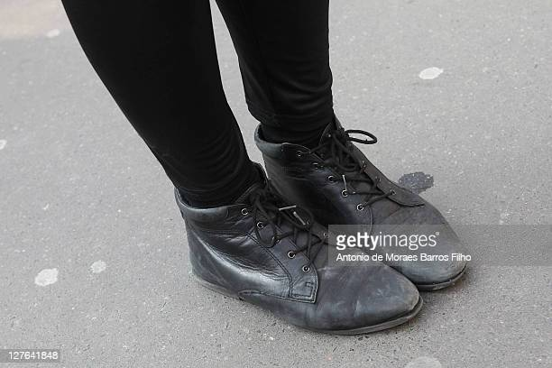 A guest arrives at Anne Valerie Hash Paris Fashion Week Fall/Winter 2012 on March 2 2011 in Paris France