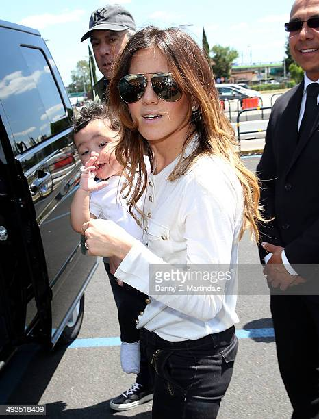 A guest arrives at Florence Airport before the Kanye West wedding to Kim Kardashian on May 24 2014 in Florence Italy