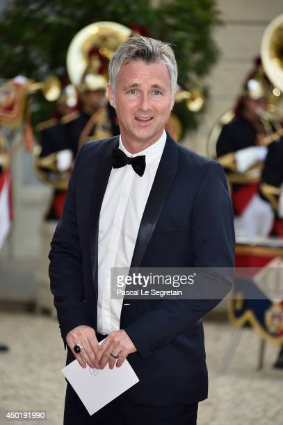 A guest arrives at the Elysee Palace for a State dinner in honor of Queen Elizabeth II hosted by French President Francois Hollande as part of a...