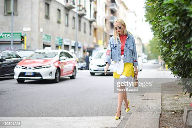 A guest arrives at the Marni show wearing Manuki top and skirt and a Salar bag during the Milan Fashion Week Spring/Summer 16 on September 27 2015 in...