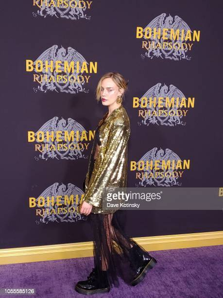 A guest arrives at the red carpet at the premiere for Bohemian Rhapsody on October 28 at The Paris Theatre in New York City at The Paris Theatre on...
