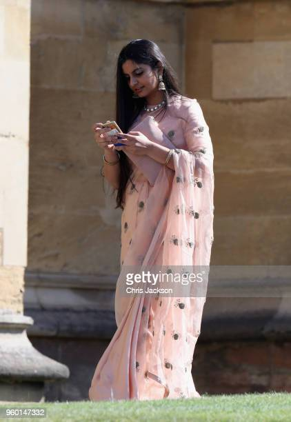 A guest arrives at the wedding of Prince Harry to Ms Meghan Markle at St George's Chapel Windsor Castle on May 19 2018 in Windsor England Prince...