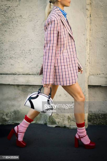 Guest arrives during the Milan Men's Fashion Week Fall/Winter 2020/202112 in Milan Italy on January 12 2020