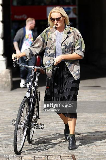A guest arrives on a bicycle to the Ashish show at London Fashion Week Spring/Summer 2012 on September 17 2011 in London England