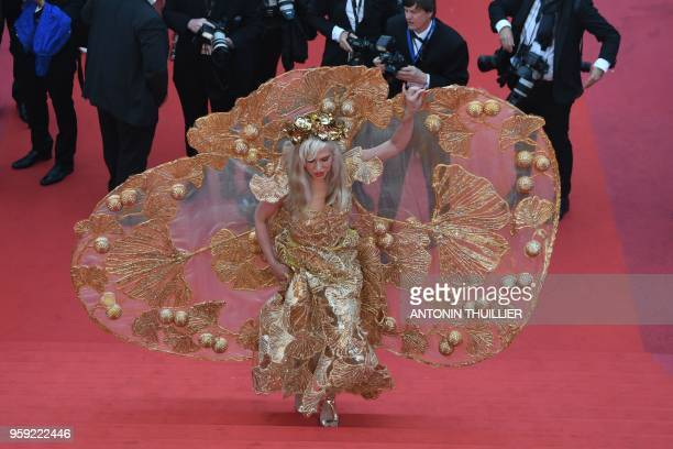 A guest arrives on May 16 2018 for the screening of the film Burning at the 71st edition of the Cannes Film Festival in Cannes southern France
