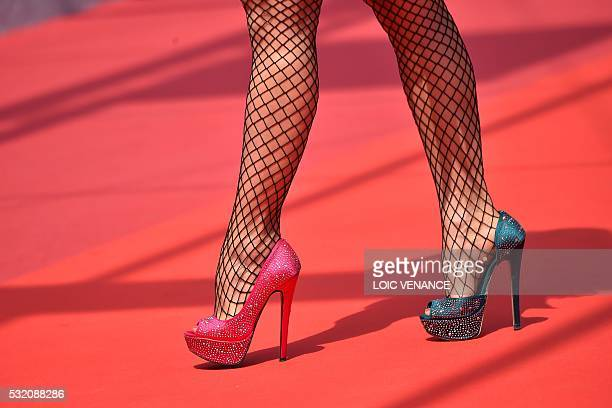 A guest arrives on May 18 2016 for the screening of the film 'Ma'Rosa' at the 69th Cannes Film Festival in Cannes southern France / AFP / LOIC VENANCE