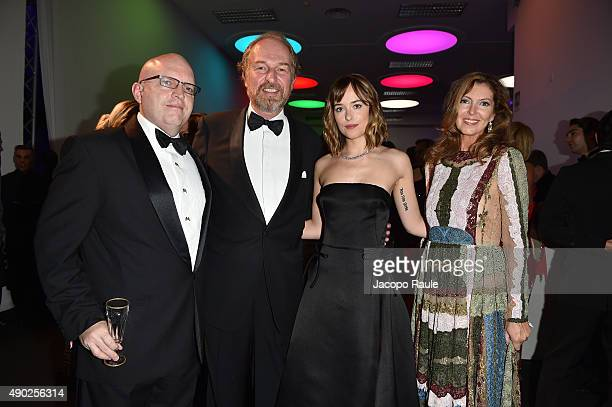 Guest Arturo Artom Dakota Johnson Anna Repin attend amfAR Milano 2015 at La Permanente on September 26 2015 in Milan Italy