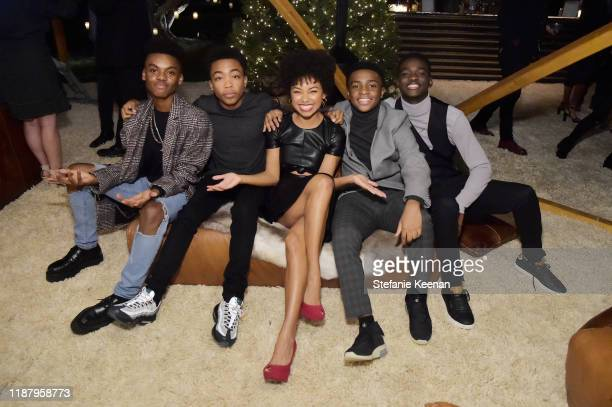 Guest Asante Blackk Logan Browning Caleel Harris and Ethan Herisse attend Celebrate the Season Ted's Holiday Toast at Private Residence on November...