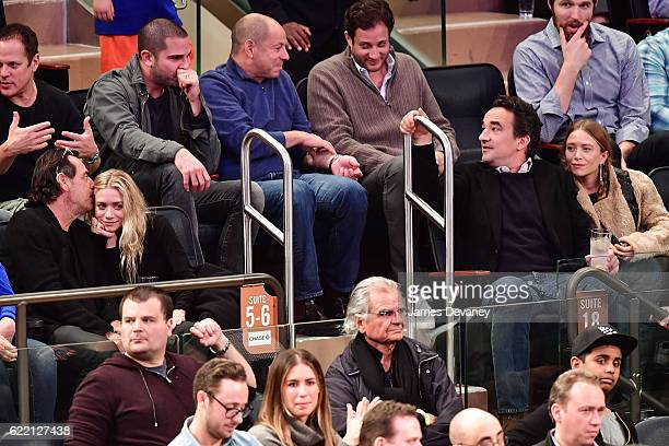 Guest Ashley Olsen Olivier Sarkozy and MaryKate Olsen attend New York Knicks vs Brooklyn Nets game at Madison Square Garden on November 9 2016 in New...