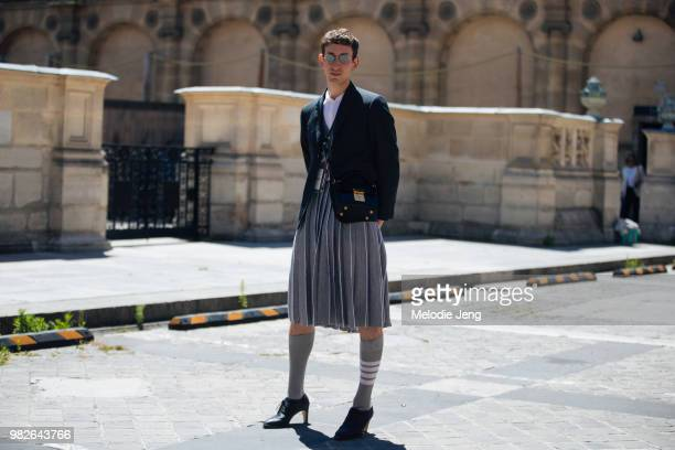 A guest at Thom Browne in a Thom Browne blazer skirt and heels during Paris Fashion Week Men's Spring/Summre 2019 on June 23 2018 in Paris France