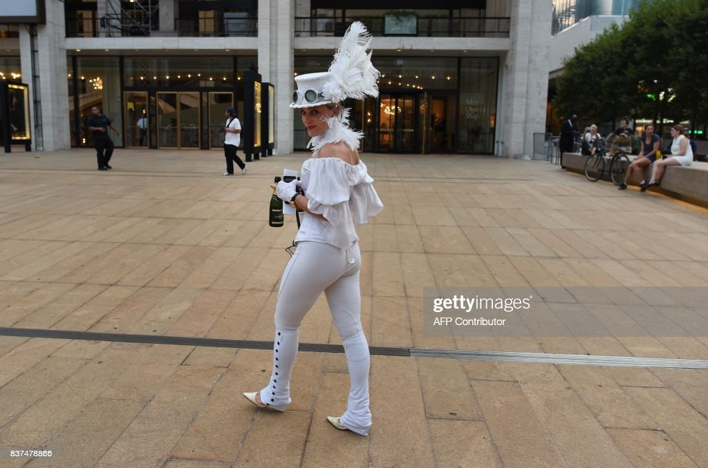 Guest attend the annual New York City Diner en Blanc, August 22, 2017, held this year at the plaza at Lincoln Center. The Diner en Blanc, the worlds only viral culinary event, a chic secret pop-up style picnic from France, the outdoor site -- always a landmark location -- is revealed at the last-minute. Guests are asked to dress entirely in elegant white, bring a picnic basket of food, fine china and silverware, white tablecloths, table and chairs. /