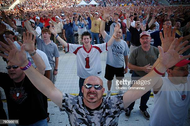Guest attend The Awakening a gathering of 25000 Promise Keepers June 10, 2006 in Razorback Stadium in Fayettville, Arkansas. Larry Ross, the reigning...
