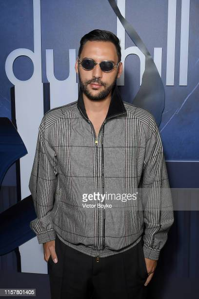 Guest attend the Dunhill Spring Summer 2020 show as part of Paris Fashion Week on June 23 2019 in Paris France