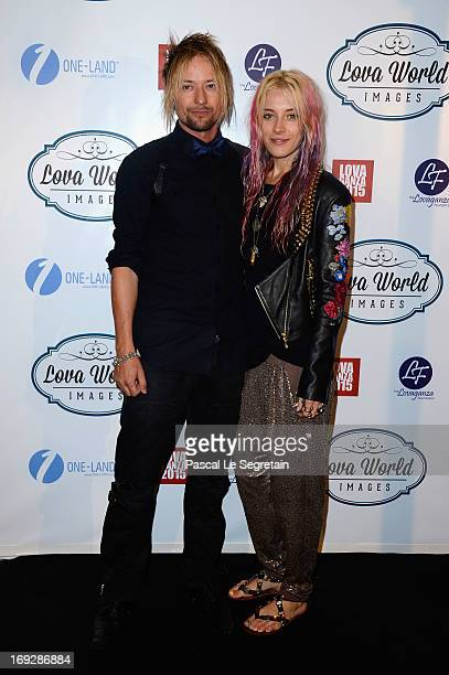 Guest attend the Lova World Images Closing Party during the 66th Annual Cannes Film Festival at Baoli Beach on May 22 2013 in Cannes France
