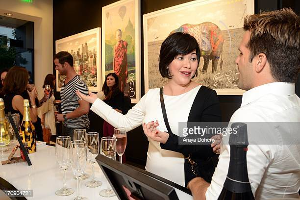 A guest attends a gallery exhibit of Terry O'Neill Presents The Opus A 50 Year Retrospective at Mouche Gallery on June 19 2013 in Beverly Hills...