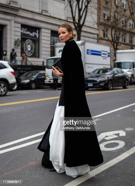 A guest attends Carolina Herrera fall 2019 runway show during New York Fashion Week held at New York Historical Society 170 Central Park West on...