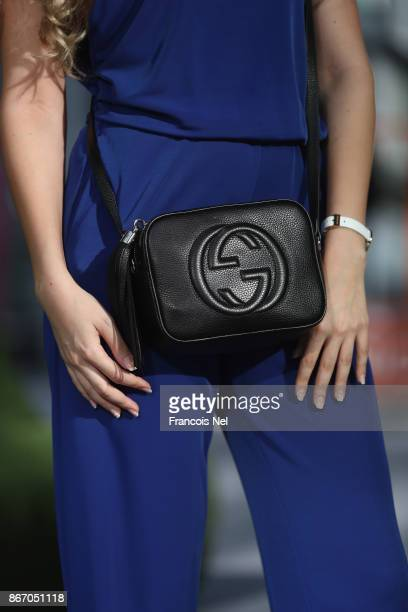 A guest attends Day 2 of Fashion Forward October 2017 held at the Dubai Design District on October 27 2017 in Dubai United Arab Emirates