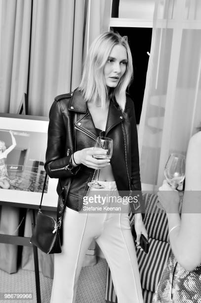 Guest attends Diesel Presents Scott Lipps Photography Exhibition 'Rocks Not Dead' at Sunset Tower on June 28 2018 in Los Angeles California