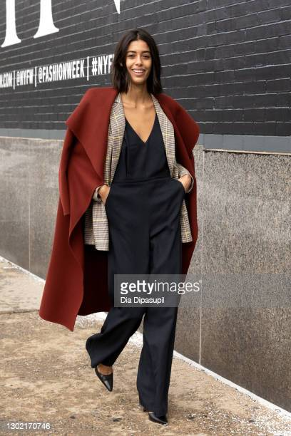 Guest attends New York Fashion Week at Spring Studios on February 14, 2021 in New York City.