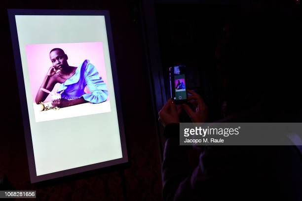 A guest attends Solve Sundsbo Beyond The Still Image exhibition opening during the Vogue Photo Festival at Palazzo Reale on November 14 2018 in Milan...
