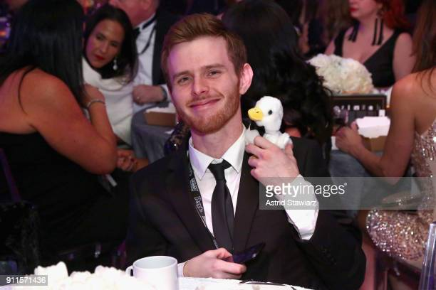 A guest attends the 60th Annual GRAMMY Awards Celebration at Marriott Marquis Hotel on January 28 2018 in New York City