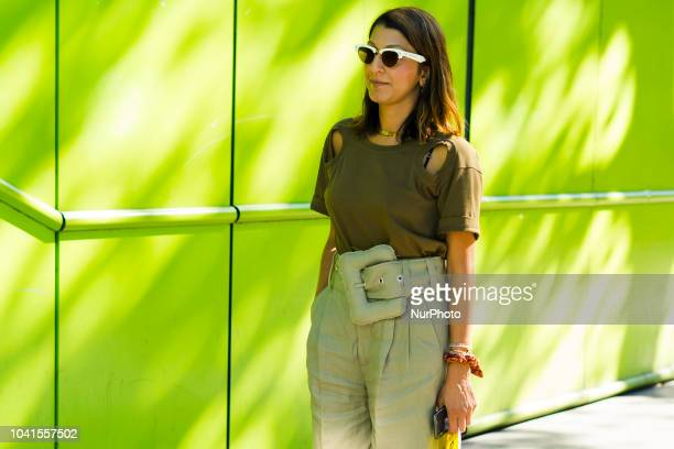 A guest attends the AALTO show as part of the Paris Fashion Week Womenswear Spring/Summer 2019 on September 26 2018 in Paris France