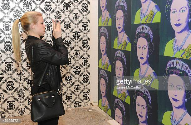 Guest attends the Andy Warhol x Flavor Paper Wallpaper Launch on November 21 2013 in New York City