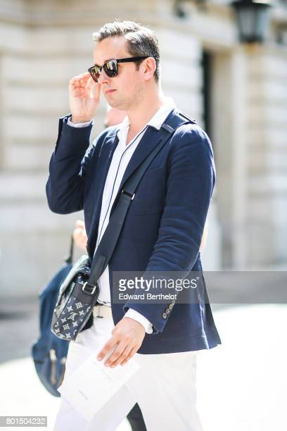 A guest attends the Balmain Menswear Spring/Summer 2018 show as part of Paris Fashion Week on June 24 2017 in Paris France