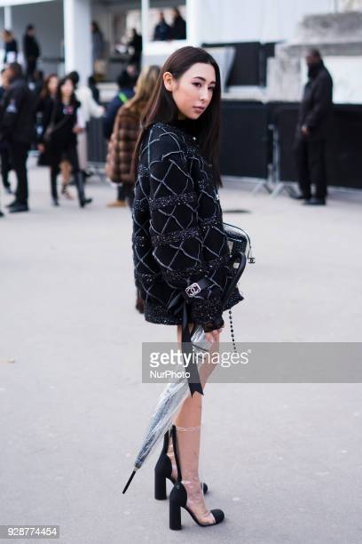 Guest attends the Chanel show as part of the Paris Fashion Week Womenswear Fall/Winter 2018/2019 at Le Grand Palais on March 6 2018 in Paris France