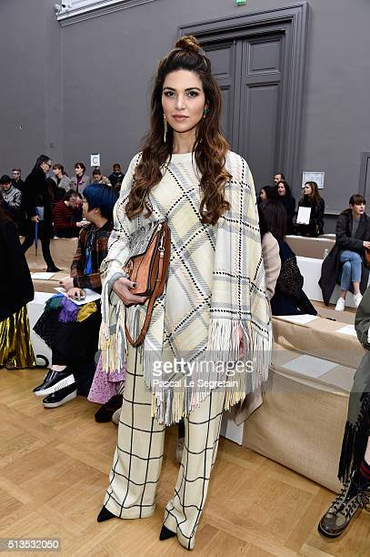 A guest attends the Chloe show as part of the Paris Fashion Week Womenswear Fall/Winter 2016/2017 on March 3 2016 in Paris France