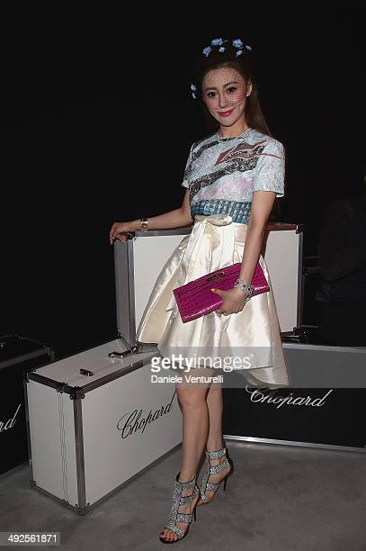 A guest attends the Chopard Backstage Cocktail Afterparty at the CannesMandelieu Aerodrome during the 67th Annual Cannes Film Festival on May 19 2014...
