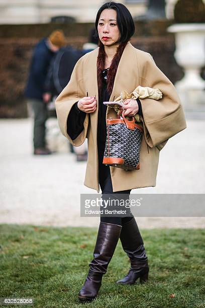A guest attends the Christian Dior Haute Couture Spring Summer 2017 show as part of Paris Fashion Week at the Rodin museum on January 23 2017 in...
