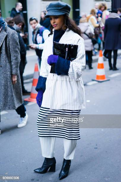A guest attends the Comme Des Garçons show as part of the Paris Fashion Week Womenswear Fall/Winter 2018/2019 on March 3 2018 in Paris France
