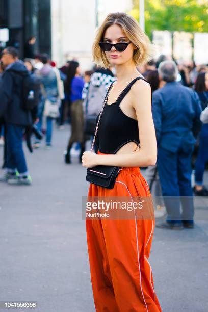 A guest attends the Dries Van Noten show as part of the Paris Fashion Week Womenswear Spring/Summer 2019 on September 26 2018 in Paris France