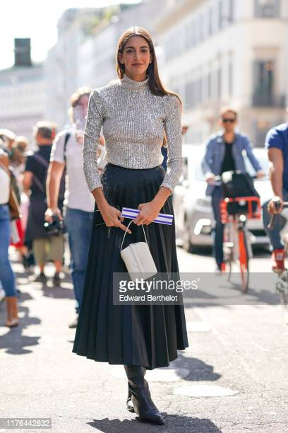 A guest attends the Ermanno Scervino show at Milan Fashion Week Spring Summer 2020 on September 21 2019 in Milan Italy